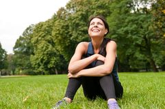 Relax - sportswoman sitting Stock Photo