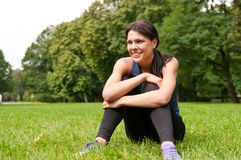 Relax - sportswoman sitting Stock Images