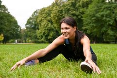 Relax - sportswoman sitting in grass Stock Images