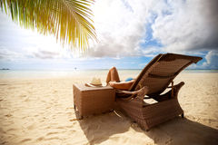 Relax on sunbeds on peaceful beach. Holiday and vacation Royalty Free Stock Photography