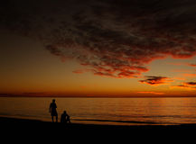 Relax in Sunset. Relax at Sunset, Colourful Clouds over Ocean, Two People watching royalty free stock photos