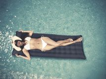 Relax in swimming pool. Beautiful girl relaxing in swimming pool Royalty Free Stock Photos