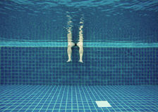 Relax in swimming pool in summer, underwater view. Relaxing in swimming pool in summer, underwater view Royalty Free Stock Images