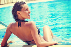 Relax in swimming pool. Young woman is relaxing in swimming pool Royalty Free Stock Image