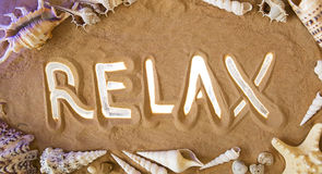 Relax symbol in the sand. Beach background. Top view Royalty Free Stock Image