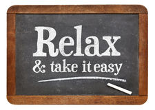 Relax and take it easy - advice on blackboard royalty free stock image