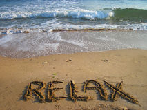 Relax - text in the sand Royalty Free Stock Images