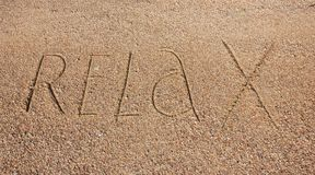 Relax text is written on sand Royalty Free Stock Images