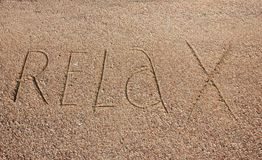 Relax text is written on sand Royalty Free Stock Photo