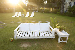 Relax time. The place for Relax on white chair on green lawn Stock Photography