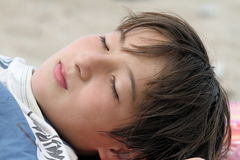 Relax time at the beach. Young teen relaxes at the beach Stock Images