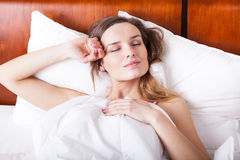 Relax time in bed. Sleeping young woman Royalty Free Stock Photos