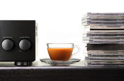 Relax time with coffee. Cup of coffee with amplifier and audio compact disc Stock Photo