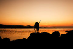 Relax time of sister on the beach. Sunset background Royalty Free Stock Images