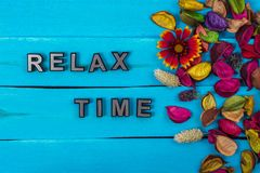 Relax time text on blue wood with flower stock image