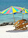 Relax time, an umbrella and two chairs. On the white beach royalty free stock photography