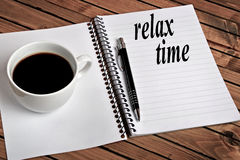 Relax time word. On notepad stock image