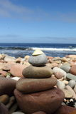 Relax. Tower of stones on the beach during sunny day Royalty Free Stock Images