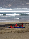 Relax after training, Lanzarote Famara. School surfing for girls rest on the beach Stock Photos