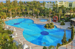 Relax in the Turkish hotel. Large swimming pool, palm trees, park recreation area. Kemer, Turkey Royalty Free Stock Image
