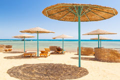 Relax under parasol on the beach of Red Sea. Egypt Royalty Free Stock Photos