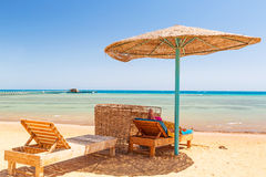 Relax under parasol on the beach of Red Sea. Egypt Royalty Free Stock Images