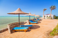 Relax under parasol on the beach. Of Red Sea, Egypt Royalty Free Stock Images