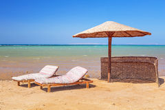 Relax under parasol on the beach. Of Red Sea, Egypt Stock Photos