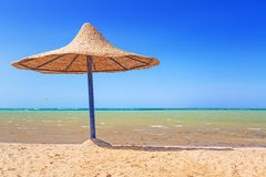Relax under parasol on the beach Royalty Free Stock Image