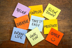 Relax, unplug, slow down, smile concept. Relax, unplug, slow down, breathe, take it easy, meditate,enjoy life, have and smile motivational lifestyle reminders on royalty free stock photo