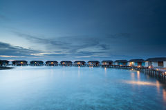Relax on water bungalow. Group of water bungalow short after sunset, malediven Royalty Free Stock Photos