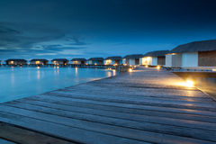 Relax on water bungalow. Group of water bungalow short after sunset, malediven Royalty Free Stock Photography