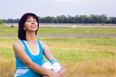 Relax woman. Relax young woman seated in a field outside Royalty Free Stock Photos