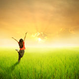 Relax Woman in green rice field and sunset Royalty Free Stock Photos