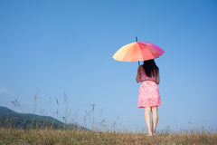 Relax Woman hold Umbrella and standing and sky on beautiful day Stock Images