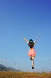 Relax Woman jumping with blue sky Royalty Free Stock Image