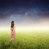 Relax woman look up to the star and standing on Green grass and Star night Stock Images