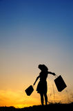 Relax Woman and shopping bags in sunset silhou Stock Photos