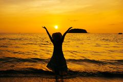 Relax Woman standing  on the beach  sea  Sunset silhouette royalty free stock photos