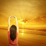 Relax Woman standing on Beach Sunset when beautiful day Stock Image