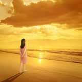 Relax Woman standing on Beach Sunset and Mountain Royalty Free Stock Photos