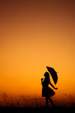 Relax woman standing and sunset silhouette Royalty Free Stock Photo