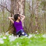 Relax in the woods. Woman decided to rest in the forest Stock Photo