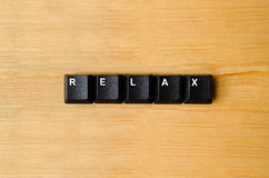 Relax word. With keyboard buttons stock images