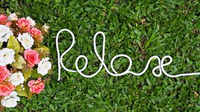 `Relax` word. Motivational hand lettering by rope. Time to Relax. Creative background for relaxation stock photography