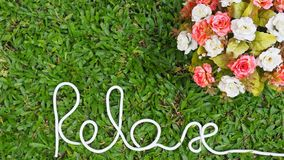 `Relax` word. Motivational hand lettering by rope. Time to Relax. Creative background for relaxation stock image