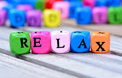 Relax word on table. Relax word on wooden table royalty free stock photography