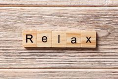 RELAX word written on wood block. RELAX text on table, concept.  royalty free stock photo