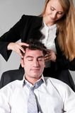 Relax after work. Young businesswoman is making head massage to her teammate Stock Photos