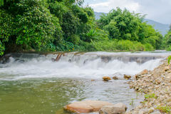 Relax after working on weekend with Stream water fall at chathaburi in thailand. Royalty Free Stock Image